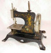 Antique Collectible And039casigeand039 Childs Wood Handled Cast Iron Toy Sewing Machine