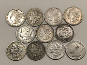 Lot Of 11 Morgan Silver Dollars. Various Dates And Some High Grade Coins