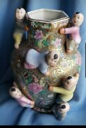 Vintage Chinese Ceramic Vase With Floral Design With Kidsand039 Figurines. 14