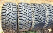 Used 4 Mud Terrain Back Country Tires On American Racing Rims 33x12.50x15lt