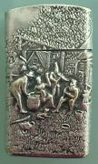 Vintage 1973 Thin Zippo Lighter With Elaborate Cover Scene