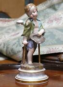 Meissen Porcelain Painted Figure Of A Young Cherub Beggar Late 19th Century