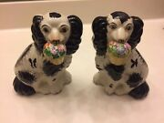 Two Staffordshire Black And White Dogs Holding Flower Baskets