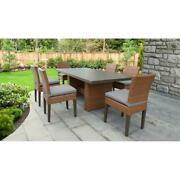 Laguna Rectangular Outdoor Patio Dining Table With 6 Armless Chairs In Grey