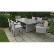 Florence Rectangular Patio Dining Table 4 Armless Chairs 2 Arm Chairs In Grey