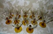 Antique Set Of 12 Hand Blown Wheel Etched Wine Glasses With An Amber Stem