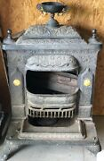A Wonderful Antique Victorian Ornate Cast Iron Parlor Stove By Regal