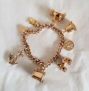 Antique 9ct Yellow Gold Curb Link Bracelet. Suspended From Are Seven Charms.