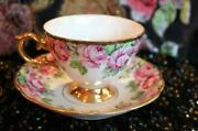 Tea Cup And Saucer By Royal Sealy With Rose