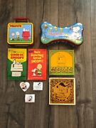 Lot Of 9 Penuts Snoopy 1 Lunchbox 1 Dog Bone Shaped Tin 4 Books And 3 Hair Clips