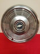 One Vintage Chevy Hubcap With Black Center And Gold Emblem