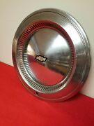 One Vintage Chevy Hubcap With Black And Silver Emblem