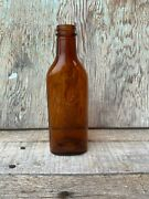 Vintage Amber/brown Glass Bottle With Fisherman Carrying Fish, 7.5 Inches