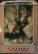 Cathay Collection Boy And Girl Porcelain Dolls Kissing On Wooden Swing, New