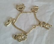 Antique Rolled Gold Bracelet. Suspended From Which Are Five Signs Of The Zodiac