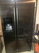 Black Stainless Samsung Refrigerator And Ice Maker