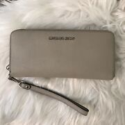 Jet Set Continental Large Zip Around Taupe Wristlet Wallet Leather