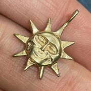 14k Yellow Gold Carved Sun Face Sun Burst Pendant. Attached Bail