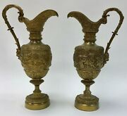 An Early 20th C. Pair Of Renaissance Revival Brass Ewers W/grape Vines And Cherubs