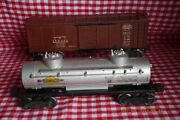Two Lionel Postwar Freights 2465 Sunoco Tank Car And Nyc X6454 Brown