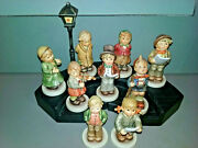 8 Hummel Choir Figurines With Stage And Lamppostplus One Unknown Figurine