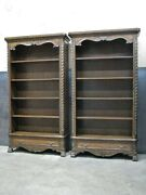 Pair Of Carved Bookcases By Hooker Furniture Leather Panels And Paw Feet