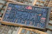 Collage Kiss Made Of Letterpress Wood Type Characters In Antique Drawer Old