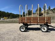 Horse Drawn Wagon With Antique Seat And Bows