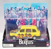 Corgi The Beatles Sgt Pepper Taxi With Album Cover Collectable. Boxed.