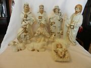 10 Piece White, Gold. And Brown Ceramic Nativity Figurine Set Wiseman, Holy Family