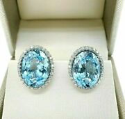 Fine 20.96 Carats T.w. Swiss Blue Topaz And Diamond Halo French Clip Earrings