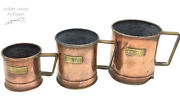 Charming Trio Of Antique Victorian Copper And Brass Embossed Grain Measuring Cups