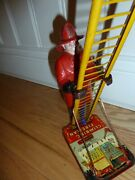 Louis Marx And Co. Smokey Joe Climbing Firefighter - Vintage Wind Up Tin Toy