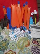 Hotwheels Track Maker Lot Of Multiple Peices Including Loop And Duel Launcher