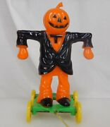 Vintage Halloween Hard Plastic Scarecrow Pull Toy Candy Container -83821