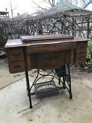 Antique New Home Treadle Sewing Machine With Beautifully Refinished Oak Cabinet