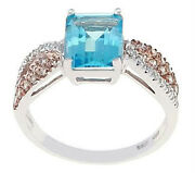 14kt White Gold Blue Topaz Ladies Ring With Side Champagne And Genunie Diamonds