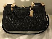 Coach Black And Gold Leather Quilted Handbag