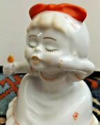 Girl With Lipstick. Vintage Russian Porcelain Figurine Kissing Lips