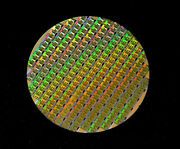 Silicon Wafer Rm7000 64bit Mips Cpu Circa 1999 With A Packaged Cpu Chip