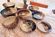 Hand thrown art studio bowls various sizes Signed DY set of 9