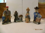 A Collection Of 4 Vintage Jim Beam Decanters