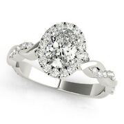 Forever One Oval Moissanite With Oval Diamond Halo And Petite Twisted Ring