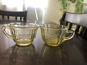 2 Depression Glass Yellow Cups Different Patterns.