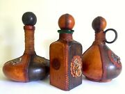 Vtg Mid Century Italian Hand Tooled Leather Wrapped Decanter Bottles - Set Of 3