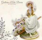 Porcelain Of Capodimonte. Lady With Hat And Wheelbarrow With Blossom