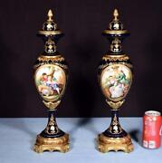 Pair Of 19 Sevres Style Cobalt Blue Porcelain Urns With Bronze Fittings
