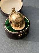 Jockey Cap Gold Charm With Hidden Locket Compass And Intaglio In Yellow Gold.