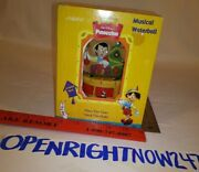 Enesco Christmas Pinocchio Musical Waterball Plays The Tune Deck The Halls