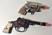2 Vintage Rodeo Cast Iron And Plastic Water Pistols - Toy Guns Both Made In Usa